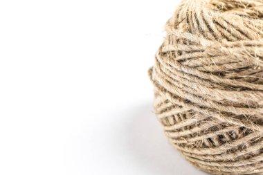 Spool of hemp rope on white background