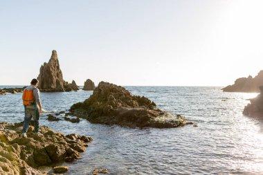 Man exploring Spanish coastline, Cabo de Gata - Nijar Natural Park, Spain