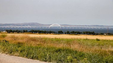 View of the Crimean bridge from the south-west direction, against the backdrop of the city of Kerch.