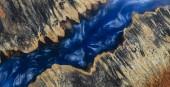 Gießen Epoxidharz stabilisierende Noppe Afzelia Holz blau Farbe abstrakte Kunst Hintergrund für Rohlinge