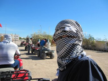 Arafat. The Palestinian keffiyeh is a gender-neutral checkered black and white scarf that is usually worn around the neck or head.