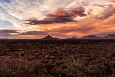 Sundowner when a big thunderstorm is coming up at Erindi Private Game Reserve in Namibia