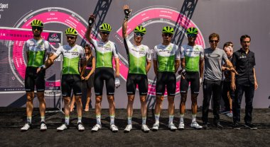 Abbiategrasso, Italy May 24, 2018: The whole Dimension Data team on the podium signatures shortly before the start of the stage of the Giro d'Italia 2018 from Abbiategrasso to Prato Nevoso.