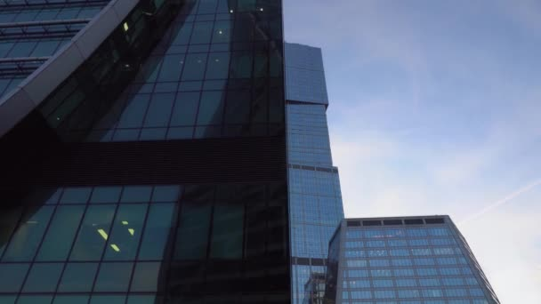 Glass facades of skyscrapers Close-up. Modern architecture, futuristic design
