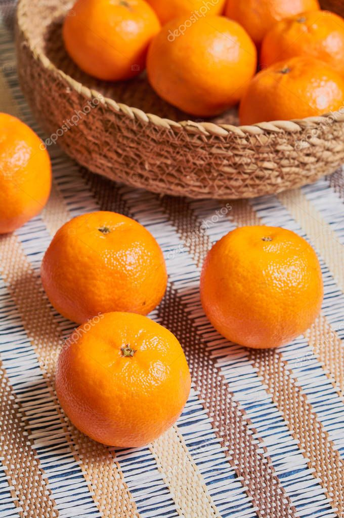 tangerine basket with artisan tablecloth background