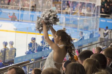 Cheerleader at a hockey game.