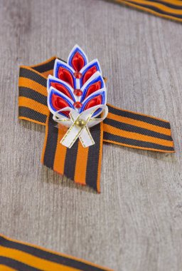 St. George ribbon victory symbol on wooden background
