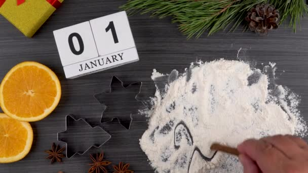 preparing festive treats for Christmas and new year holidays. calendar with the date January 01. bull as a symbol of the new year 2021. flat layout. cookie molds and flour. orange and star anise.