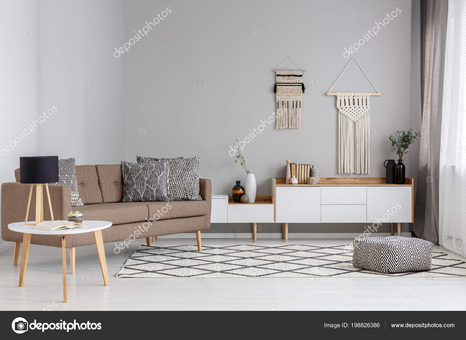 Patterned pouf carpet brown sofa modern living room interior lamp stock photo