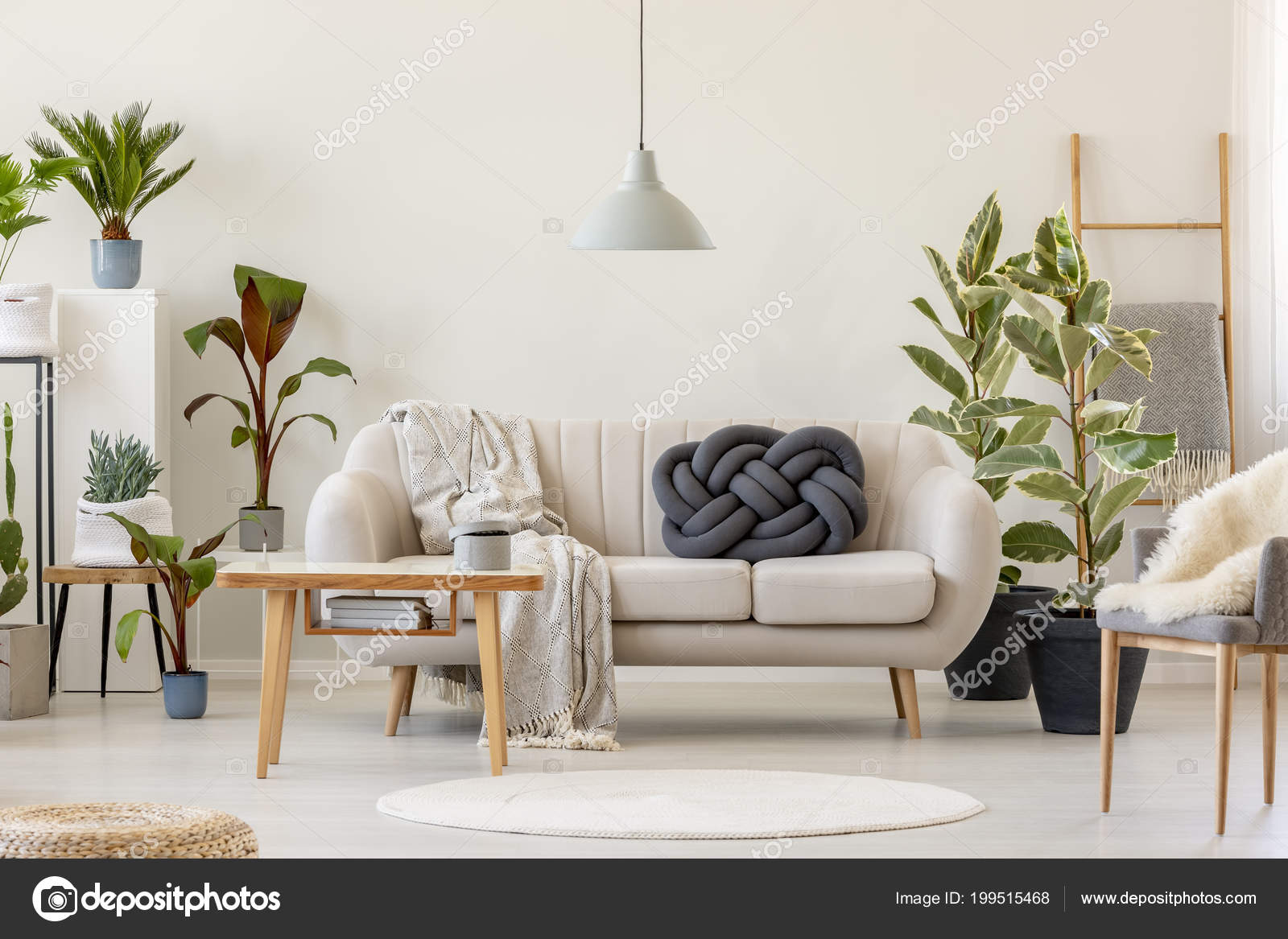 wooden table front beige sofa floral living room interior plants rh depositphotos com coffee table in front of reclining sofa there is a table in front of the sofa