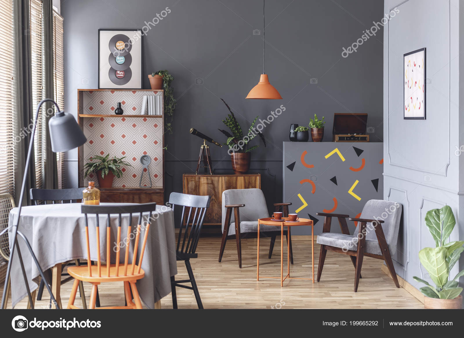 Grey Dining Room Interior With A Table Chairs Lamp Plants Sitting Corner Wooden Cabinets And Confetti On The Wall Photo By