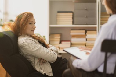 Stressed woman listening to personal life coach during therapy