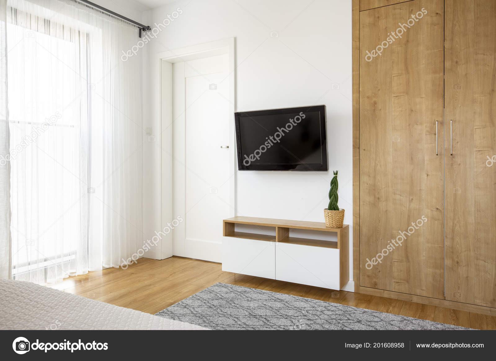 Picture of: Wooden Wardrobe Next Television White Wall Hotel Bedroom Interior Door Stock Photo C Photographee Eu 201608958