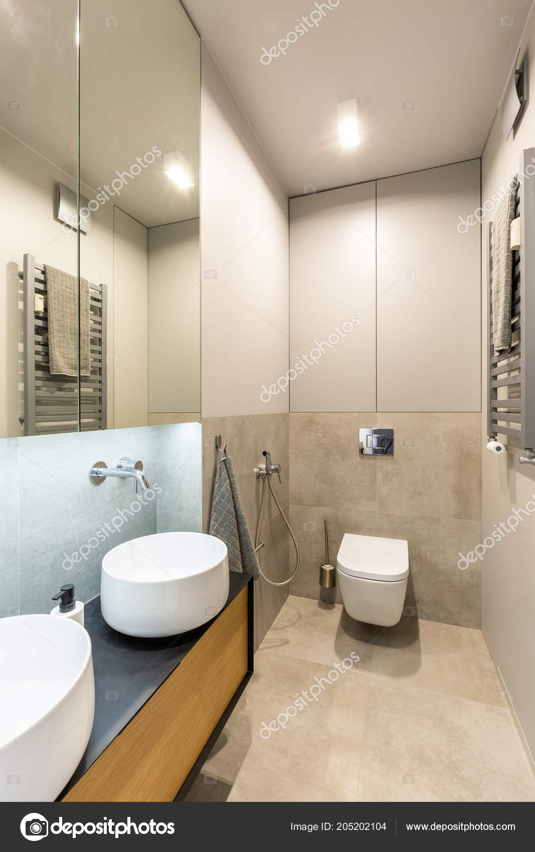 Ceramic Washbasins And Toilet In A Modern, Fancy Bathroom Interior With  Beige, Marble Tiles And Wooden Furnitureu2013 Stock Image