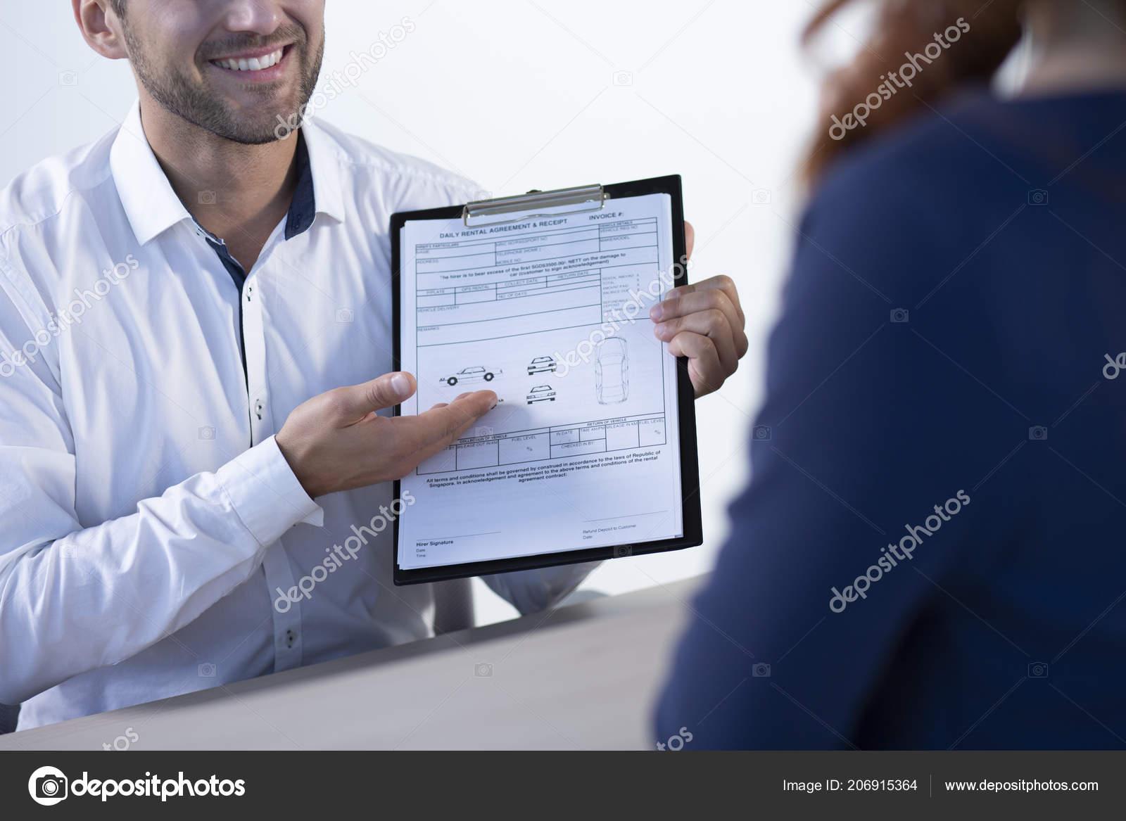 Smiling Professional Car Dealer Showing Daily Rental