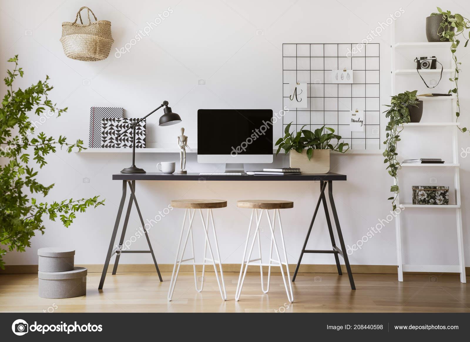 Desktop computer mock-up on an industrial desk in a scandinavian student  bedroom interior workspace with white walls 50