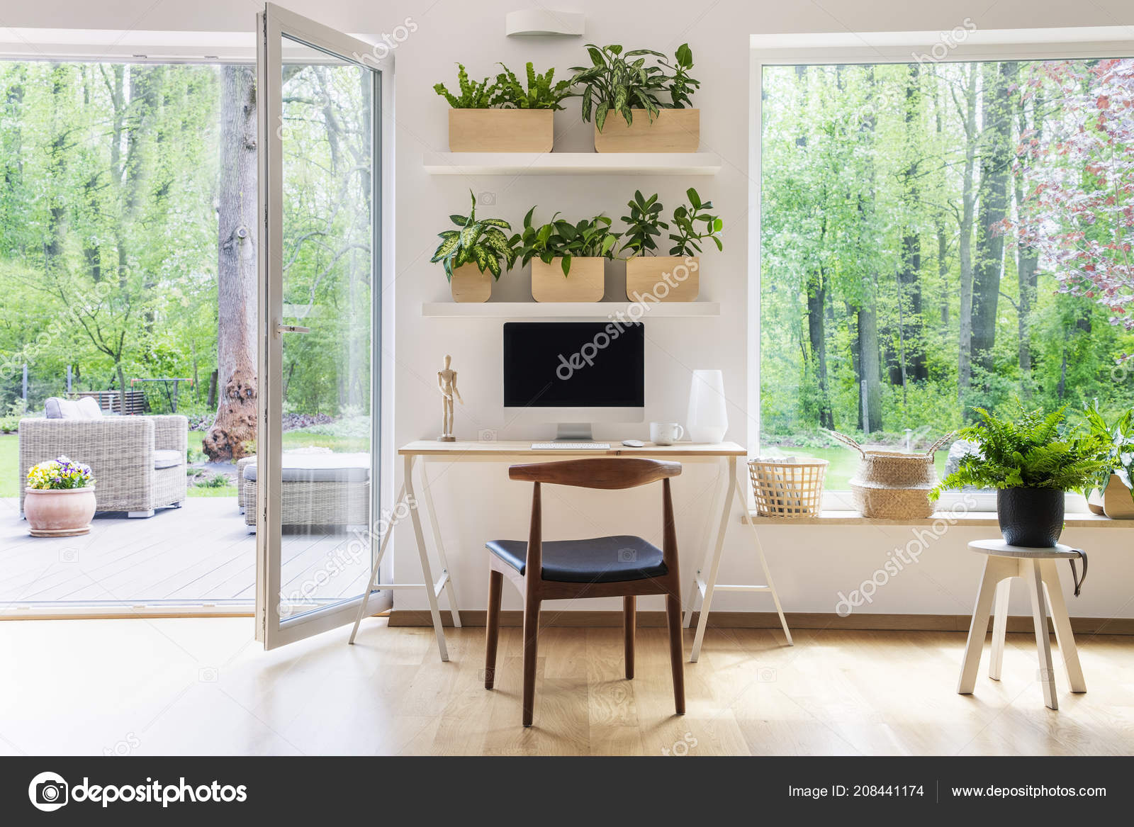 Zen home office with computer in a beautiful, spacious living room interior  with plants and an outside view through big windows 9