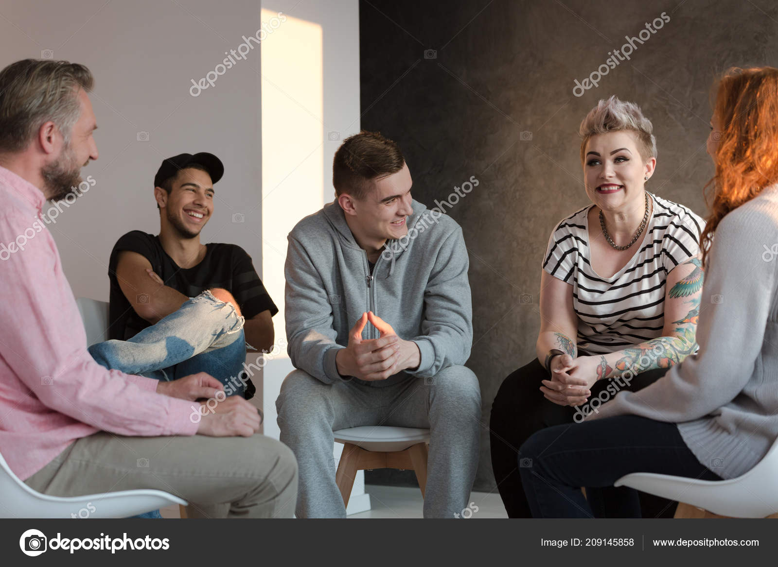Behavioral Problems In Youths Are >> Teenagers Laughing Group Counseling Session Youth Emotional