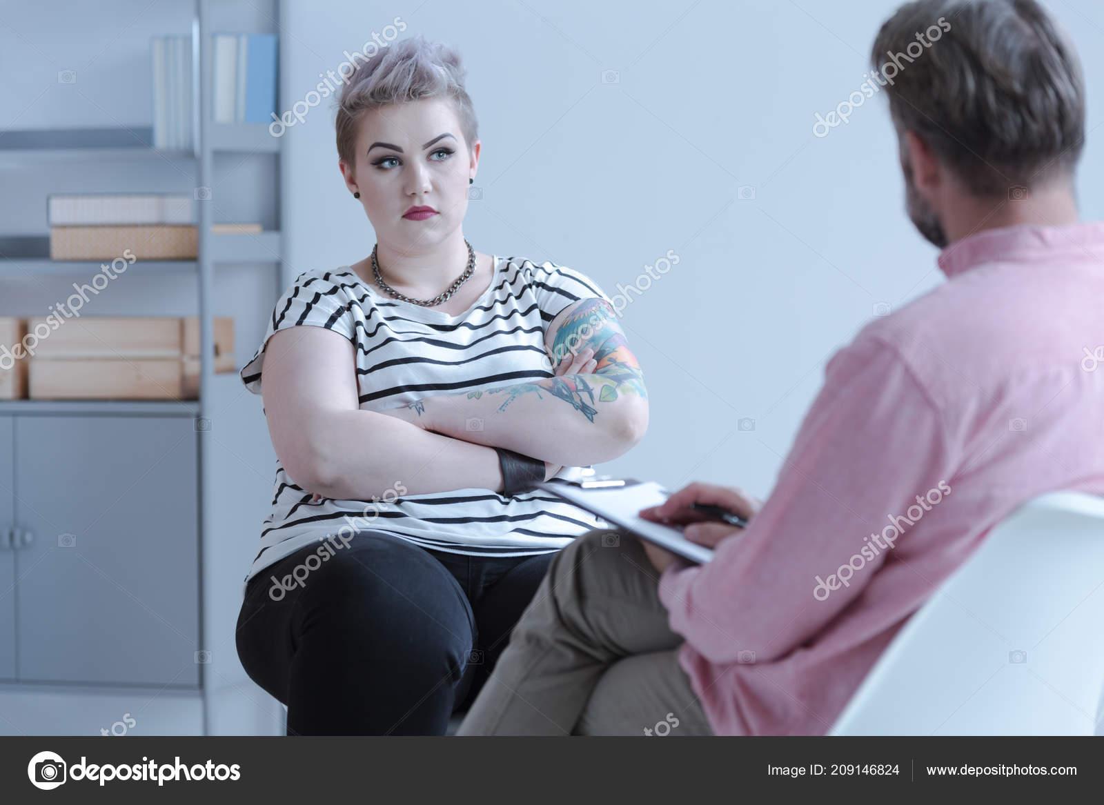Tattooed Defiant Teenage Girl Sitting Closed Posture
