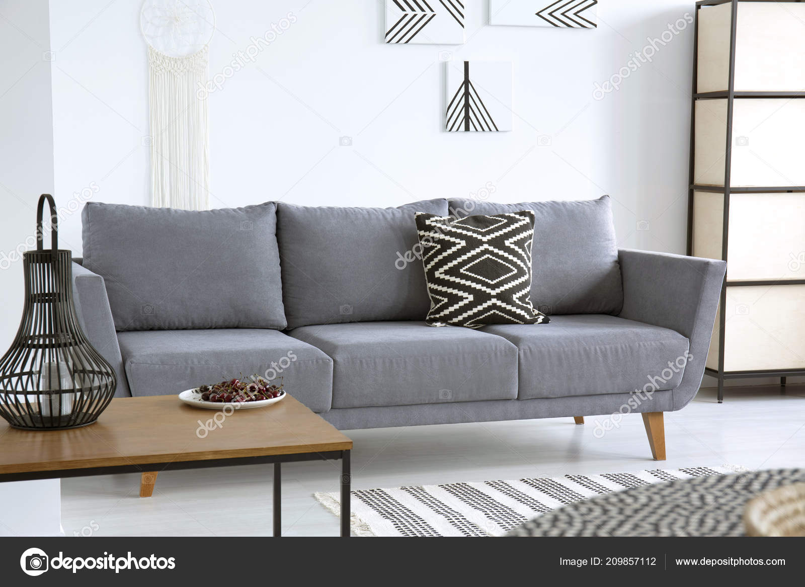 Lantern Table Grey Sofa Patterned Cushion White Living Room