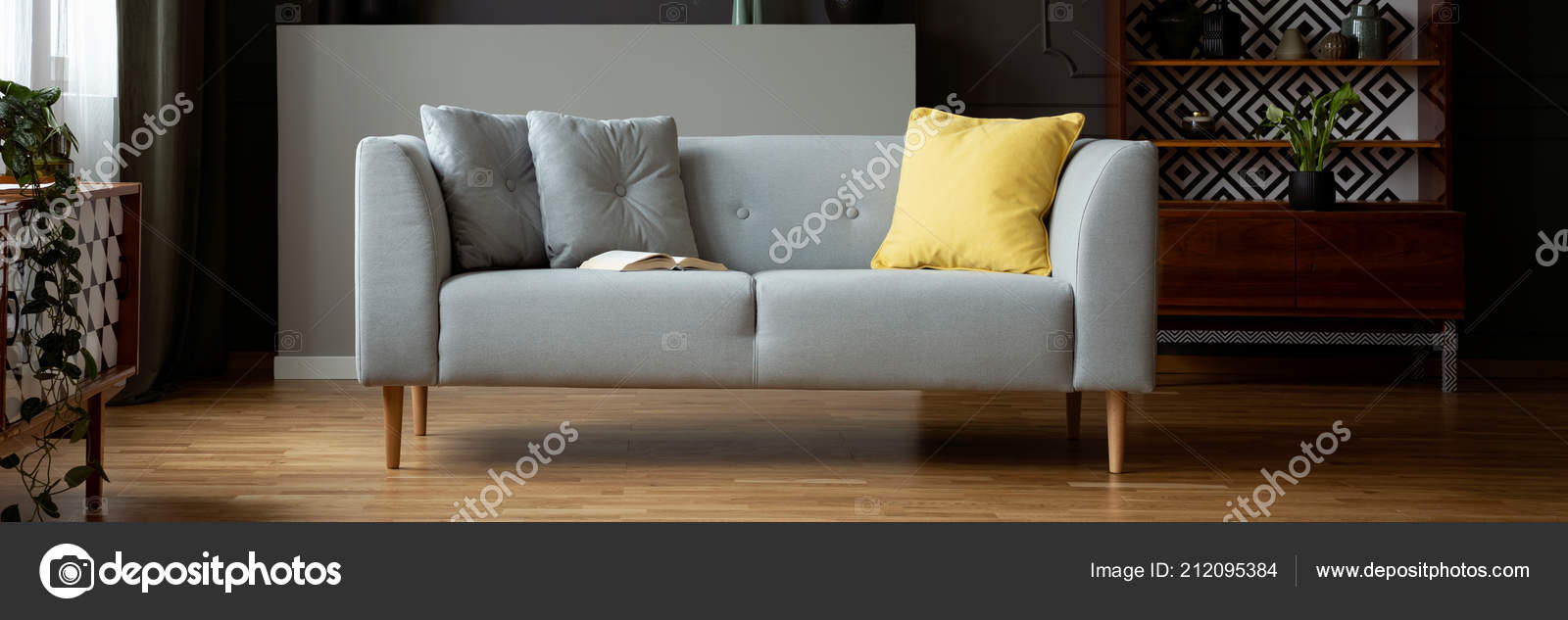Grey Sofa Yellow Cushion Open Book Real Photo Dark Vintage Stock