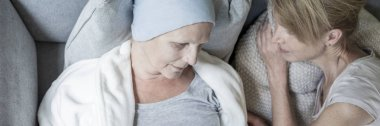 Panorama and top view on caregiver supporting sick senior woman with cancer