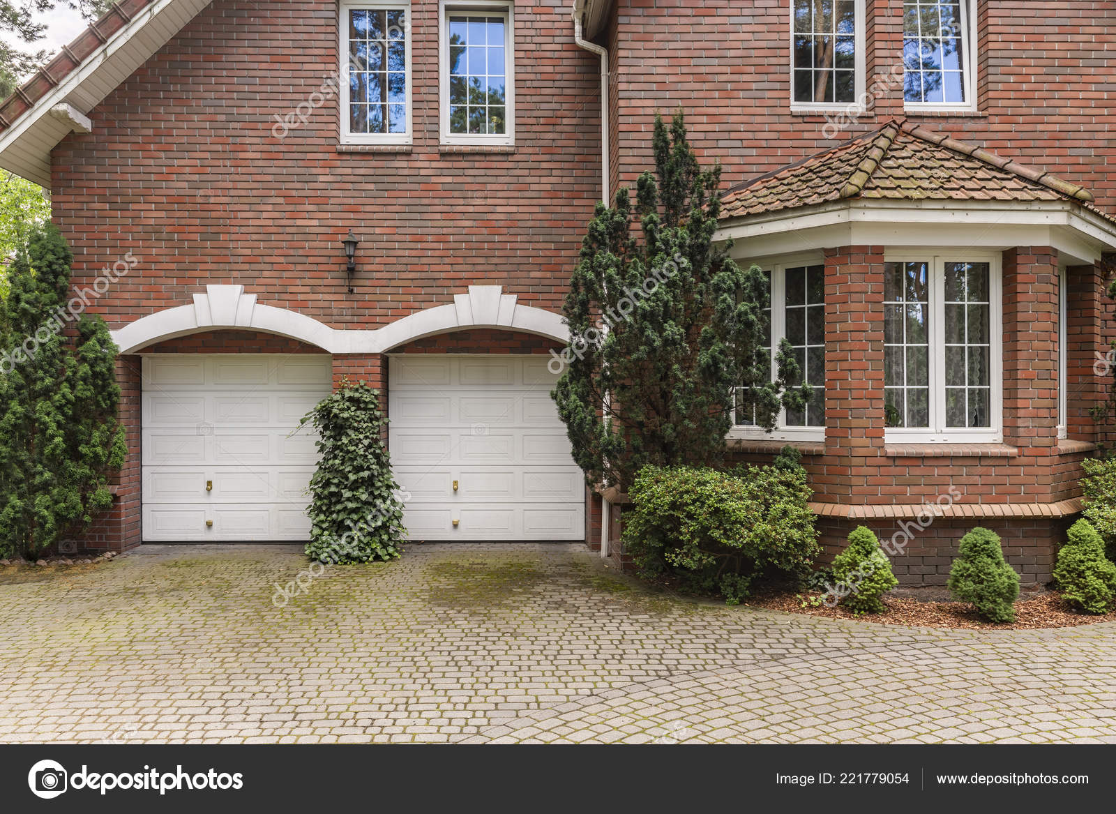 Irish Cottage Interiors Red Brick Classic Style House White Garage Doors Window Frames Stock Photo C Photographee Eu 221779054