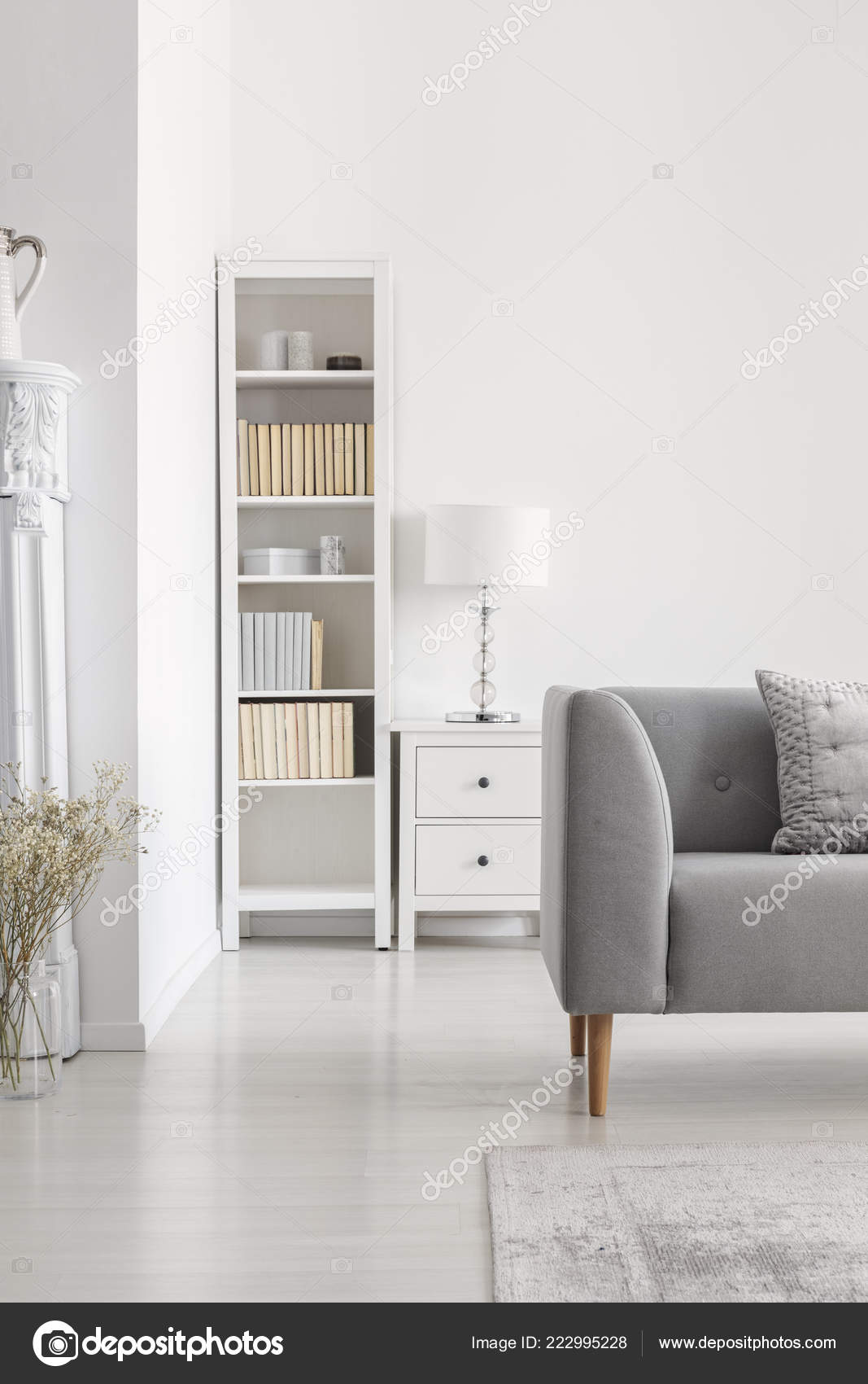 Bookshelf Next To Cabinet With Lamp In White Living Room Interior Grey Couch And Plant Real Photo By Photographeeeu