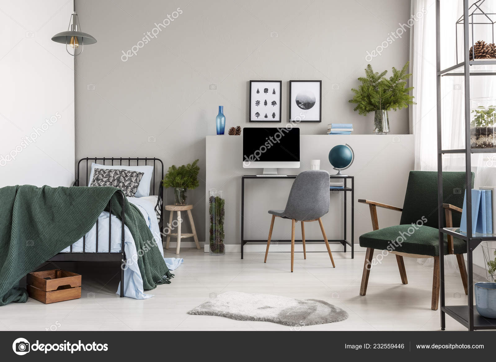 Grey chair at desk in stylish scandinavian bedroom with home office, real  photo with copy space on the empty grey wall 34