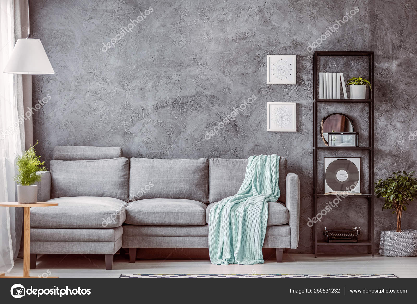 Mint Green Blanket On Grey Comfortable Couch In Contemporary