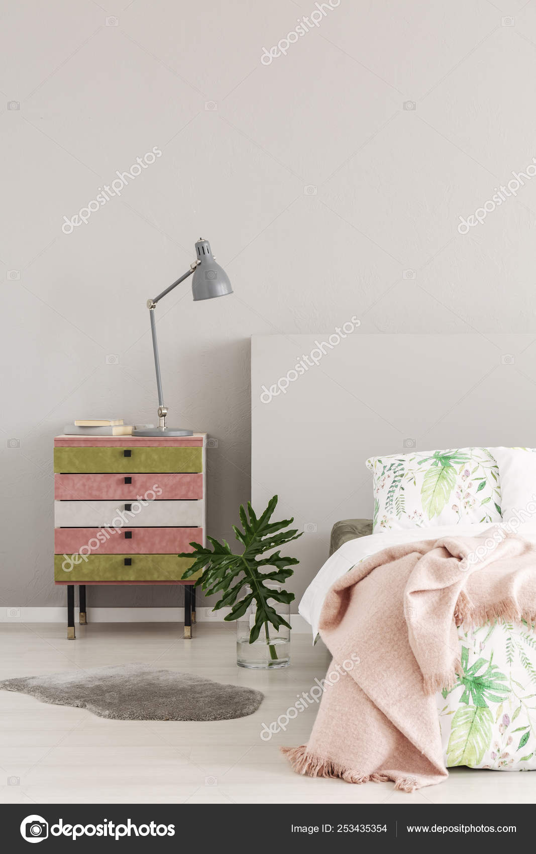 Olive Green And Pastel Pink Colored Nightstand Next To Glass Vase With Leaf In Simple Bedroom Interior Copy Space On The Empty Grey Wall Stock Photo C Photographee Eu 253435354
