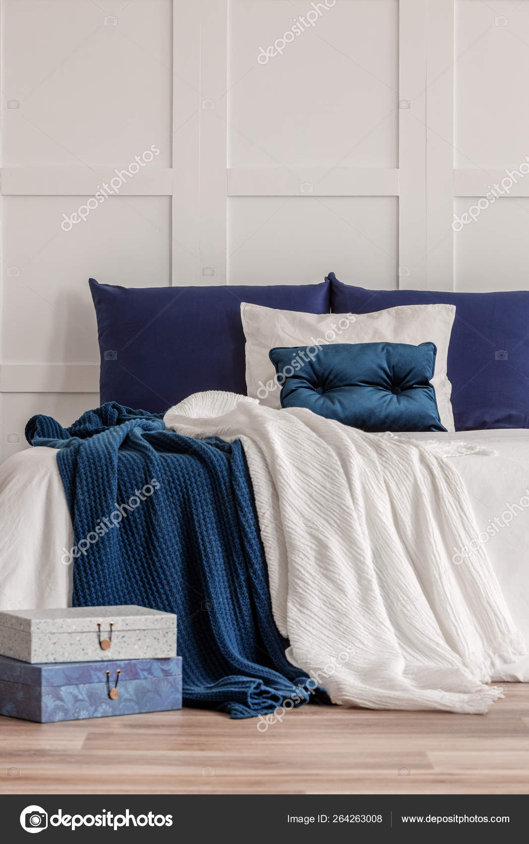 Simple Navy Blue And White Bedroom Interior With Cozy Bed With Pillows And Duvet Stock Photo C Photographee Eu 264263008
