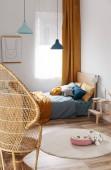 Photo Stylish blue and orange kids bedroom design in bright apartment
