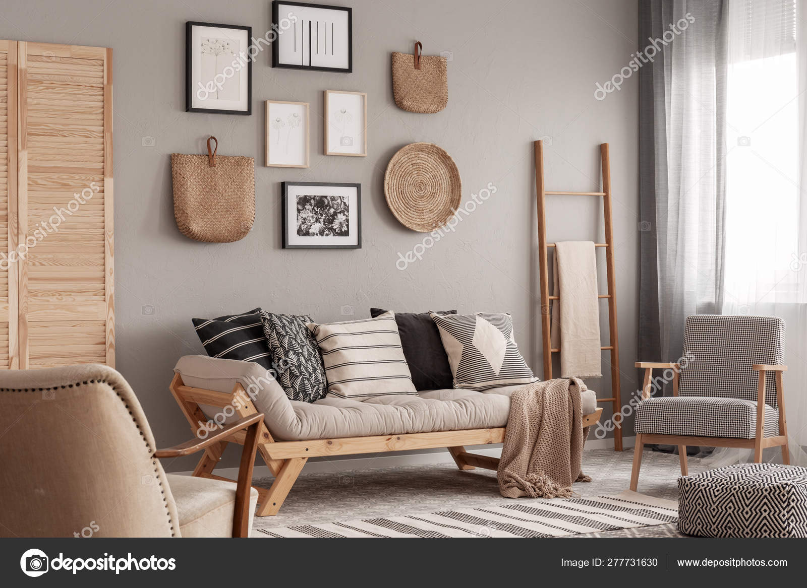 Trendy vintage armchair next to chic scandinavian sofa with ...