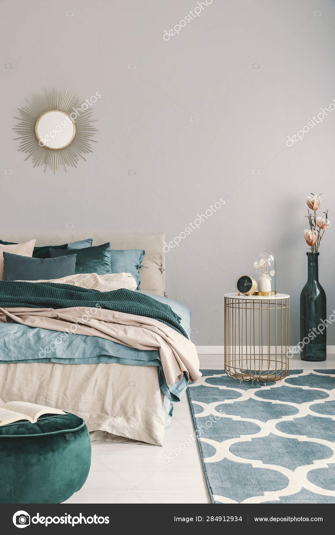 Flowers In Stylish Bottle Like Vase Next To Trendy Nightstand With Clock In Beautiful Bedroom Interior With Beige And Emerald Green Bedding Stock Photo C Photographee Eu 284912934