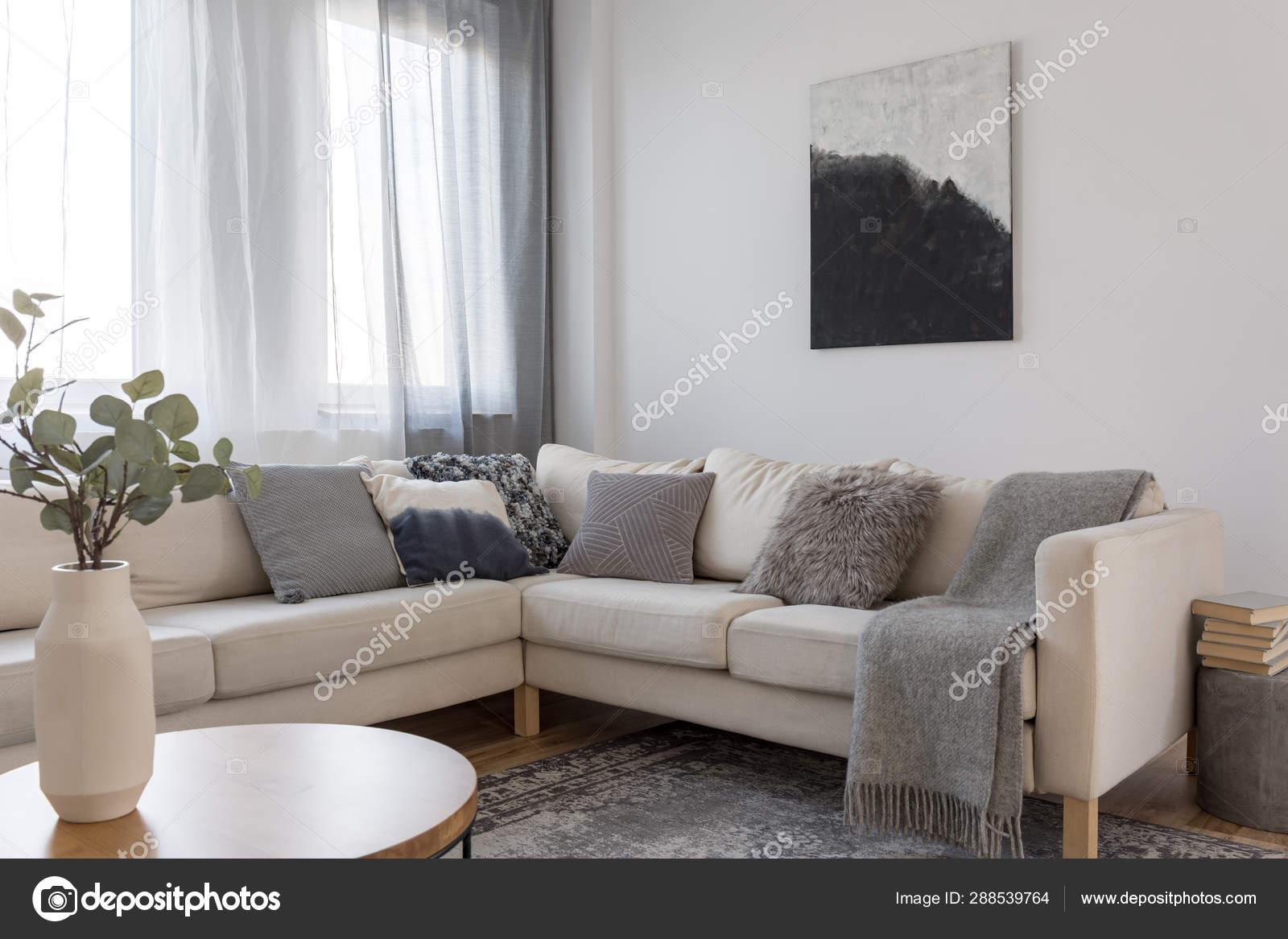 Beige Comfortable Corner Sofa With Grey Pillows In Elegant
