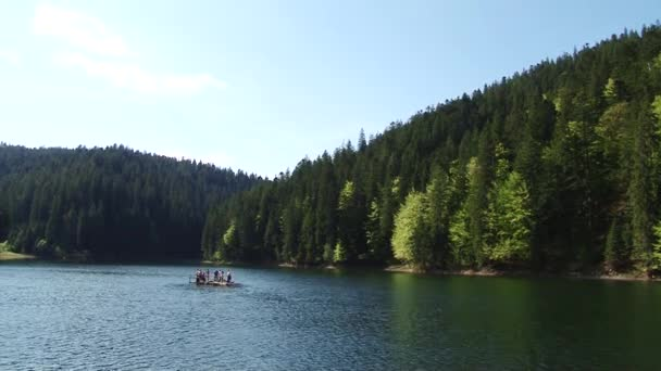 Beautiful landscape of big lake surrounded by forest and mountains.