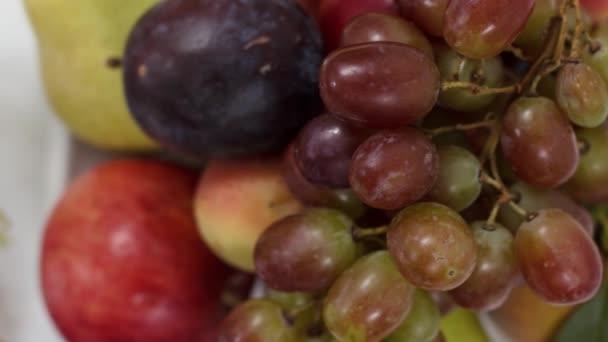 Fresh ripe fruits on kitchen table