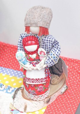 Dolls symbolizing a family with children, handmade in national clothes.