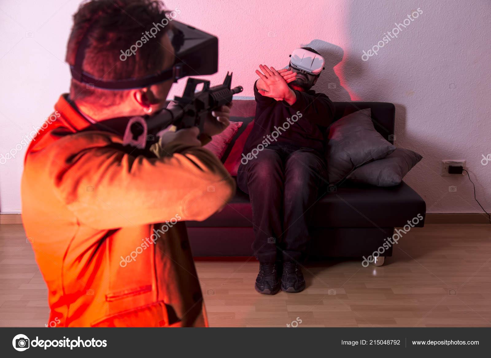 Two Men Glasses Simulation Game Gun — Stock Photo © Kuassar