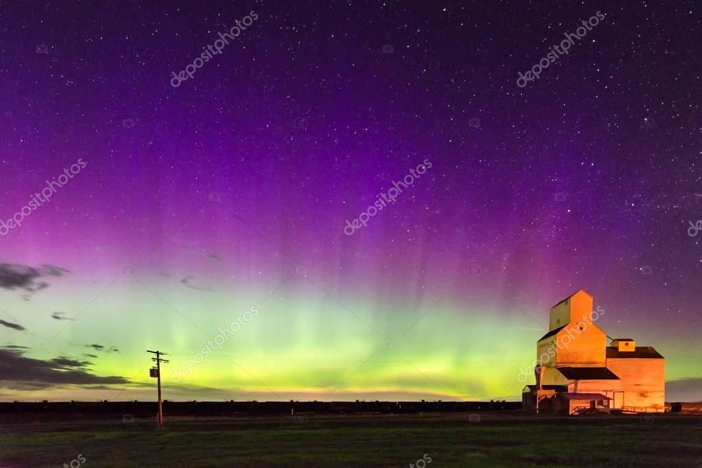 Aurora Borealis over a historic grain elevator in Pennant, Saskatchewan, Canada