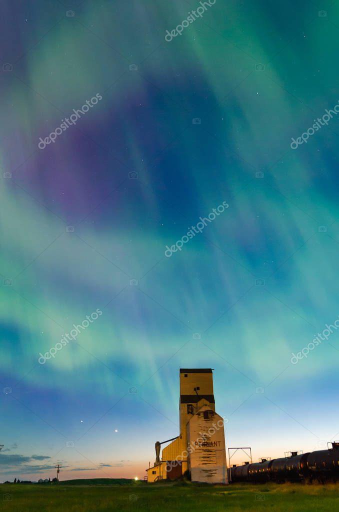 Heart shaped Aurora Borealis over a historic grain elevator in Pennant, Saskatchewan, Canada