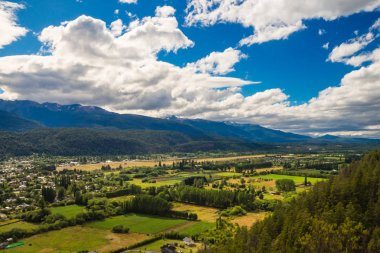 The green valley of El Bolson in argentinian Patagonia. The Andes and the forest