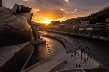 1/MAY/2019 BILBAO SPAIN; Bilbao riverside near Guggenheim Museum during the sunset