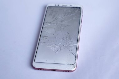 cracked phone screen, broken and crushed cell phone sensor. on white background