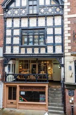 Chester, UK: Jun 14, 2020: An historic building on Chester's famous Rows bears the inscription Gods Providence is Mine Inheritance.