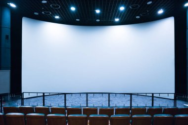 Empty stage in the small movie theater with white screen