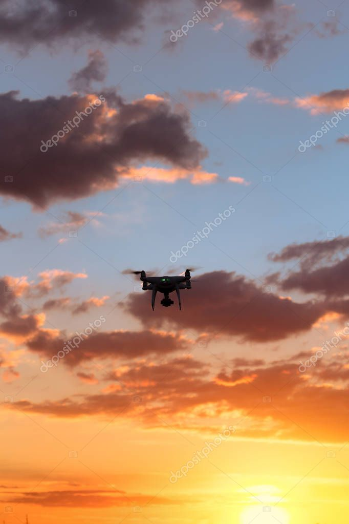 flying drone on the background of a beautiful sunset / beautiful sky drone doing its job