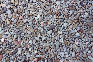 sea pebbles background of sea stones / background photo natural colors