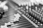 Photo Professional music production in a sound recording studio, mixer desk
